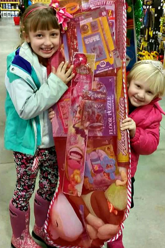 Callie and Chloe Weisz, daughters of Chase and Hannah Weisz, were the lucky winners of a drawing for a giant stocking full of toys at Early Bird Supply in Grangeville.