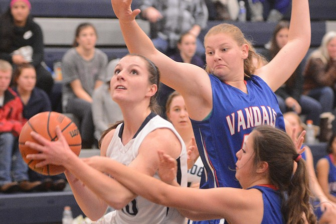 With nearly 18 points per game through the early winter, Grangeville's Hailey Sullivan has steadied the girls team in the absence of fellow seniors Sarah Wilson and Madison Brown, who are out with injuries. By coach Larson Anderson's estimate, the sidelining of the two athletic standouts has cost the Bulldogs about 20 points per game — nearly half the total the team averaged a year ago. Pictured, Sullivan scores a layup, and draws a foul in the process. The Grangeville girls (3-3) are off for the rest of 2015, and are set to resume Jan. 2 at CDACharter.