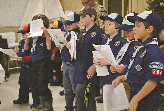 After badges were handed out and pizza was consumed, members of the White Salmon Cub Scouts Troop, Pack #384, practiced their Christmas carols Monday night, Dec. 21, before venturing out in the snow to sing for residents of the Beth-El Shalom Senior Citizen Center. The Pack has re-emerged in the community this year after disbanding a few years ago.