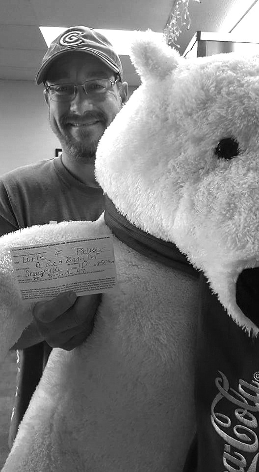 Contributed photo Lorie Palmer was the winner of the Coca Cola Polar Bear drawing at Grangeville's Pizza Factory. Matt Dame (Inland Cellular, Grangeville High School athletic director) drew the winning name and is pictured here with the bear.