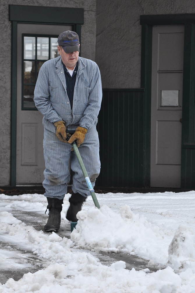 Cost Of Doing Business: Sometimes the cost of business is just making it so customers can make it in through the front door. Dave Robinson of Robinson's Garage on Main Street in Grangeville was among those last Friday morning, Jan. 8, shoveling their front walks at the start of the business day.