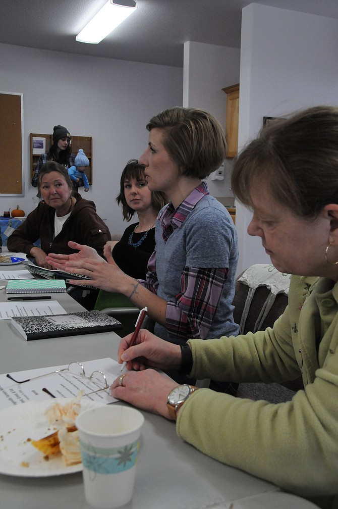 The steering committee for the Grangeville Farmers' Market (L-R) Michelle Perdue, Jamie Everson, Ellissa Crowl and Jennifer Artley, discuss the 2016 market at the Meet, Eat and Greet held Saturday, Feb. 27, at the Soltman Center.