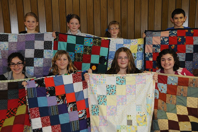 Eight homeschooled students recently made quilts for the Ronald McDonald House. They are (top, L-R) Mari Schwartz, Kate Foster, Maggie Foster and Elijah Gulotta and (bottom, L-R) Michaela Gulotta, Hilde McGuigan, Mary McGuigan and Rachel Gulotta.