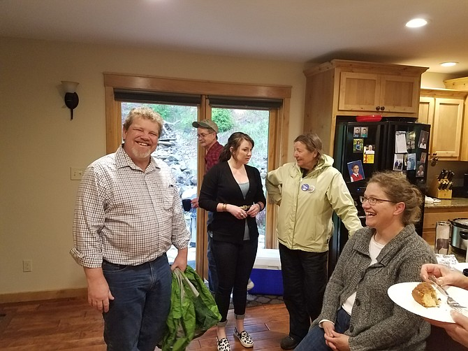 """Contributed Photo / Bill Farmer Idaho County Democrats held a """"Party Within the Party"""" Saturday, April 23, at John and Laurie Andrechak's home on the Middle Fork. Pictured are James Piotrowski and Jessica Chilcott in foreground; and Jerry Zumalt, Grangeville, Robin LeeBeusan, Boise, Michelle Perdue, Grangeville."""
