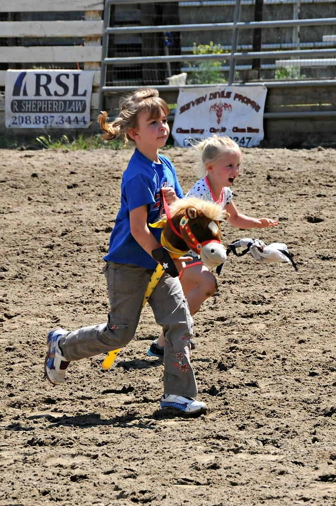 Stick horse races are a tradition at the Riggins Rodeo. These little girls were galloping along Sunday, May 8.