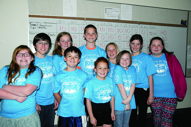 Grangeville Elementary Middle School Battle of the Books winners — who went 10 rounds in the final contest — are shown against their scoreboard. They are (front, L-R) Maggie Kohrman, Reese Pollan, Tesslynn Beeson and Sydney Roach and (back, L-R) Toby Stoner, Alyson Schiess, Thomas Kaschmitter, Tabitha Stoner, Sydney Newson and Abbigail Sandoval.