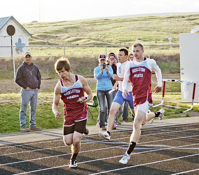 Nathan Powers hands off the baton to teammate Joseph Cummings during the 1,600 meter relay at the Pirate Invitational.