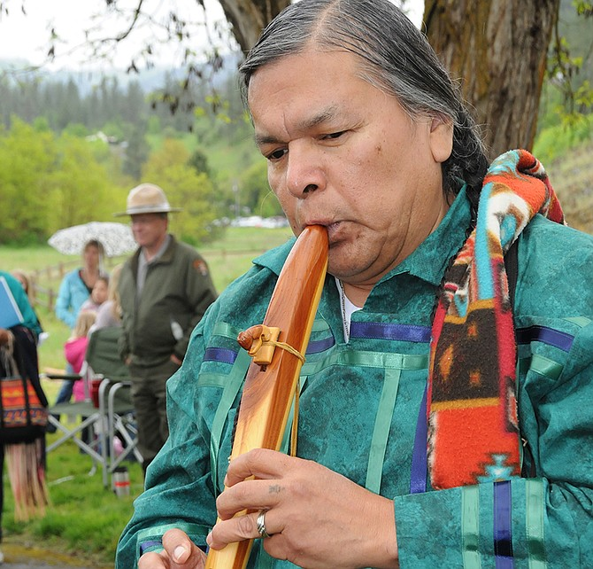 """James Wheeler, Sr., of Kamiah plays a flute he hand carved. He made his first flute when he was 12. He taught himself to both play and make the instruments. """"I taught myself with some help,"""" he smiled, pointing skyward. Wheeler played the flute pictured here as well as his first flute."""