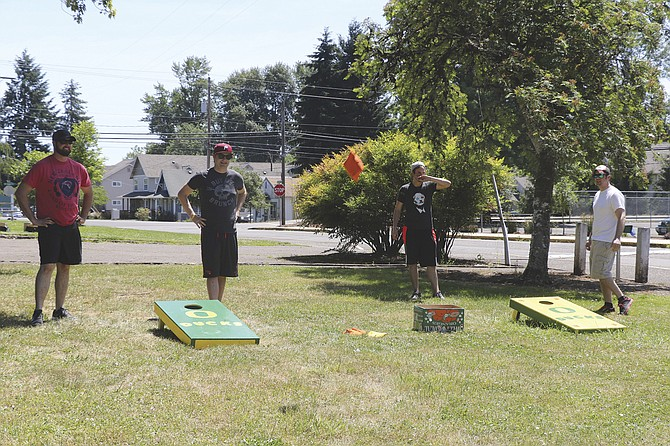 Corn hole was one of three events at the triathlon field games on Saturday.