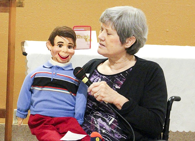 Faye Pruitt and her pal Willie entertain the Lower Valley Christian Women's group Tuesday as the Newburg, Ore. ventriloquist shares her testimony.