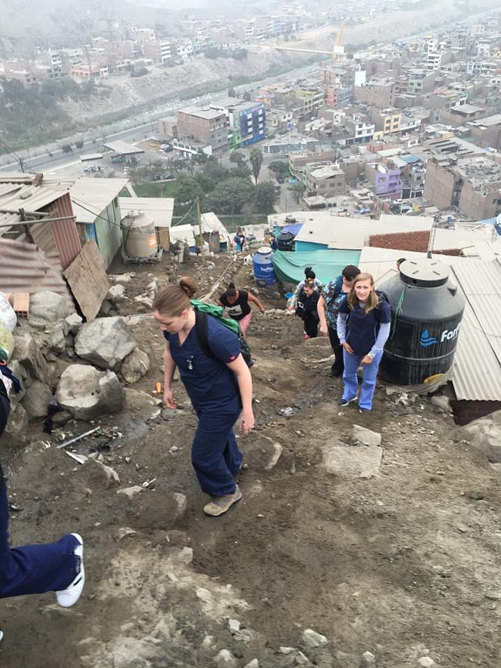 former cv student makes medical mission trip to peru contributed photo christine schmidt and her team travel up hillsides to visit patients in a village