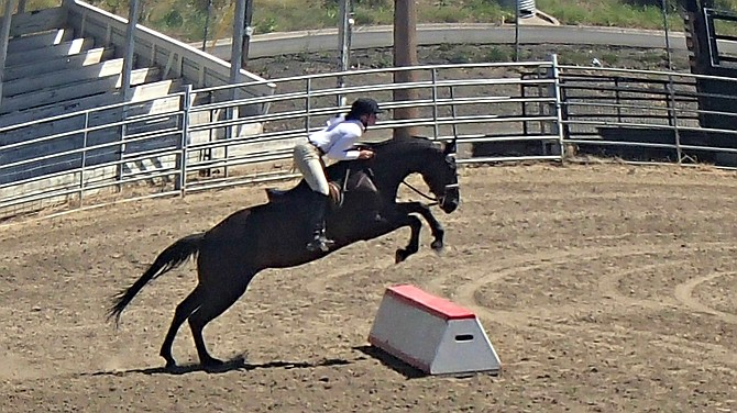 IdahoCounty 4-H Horse Show participants Molly Van Steenwyk of Grangeville makes a jump in the Hunt Seat Equitation. Van Steenwyk garnered the Intermediate Champion award in this event.  Contributed photo