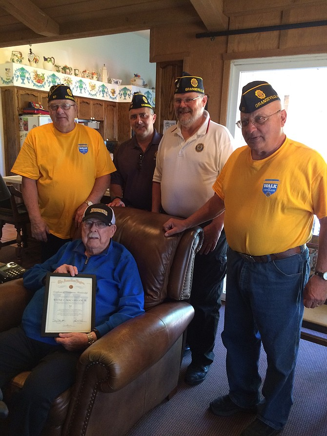 Members of Grangeville American Legion Post 37 recently visited Wayne MacGregor at his home in Grangeville to present him with a certificate honoring his 70 continuous years of membership in the American Legion. Making the presentation were Don Owen, Post Commander, Dick Seay, John Nida, Adjutant and Morris Bentley, Service Officer.