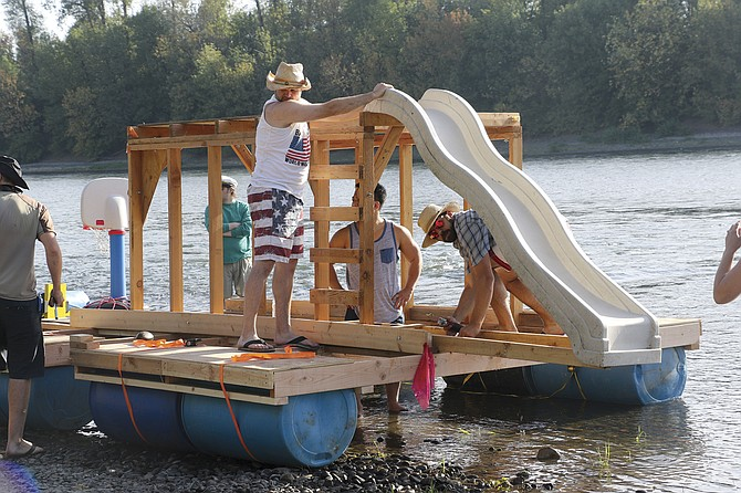 The Philip Rivers boat makes preparations before the start of the Great Willamette Raft Race.
