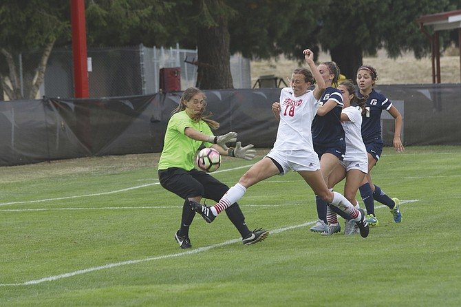 Western Oregon senior Shelby Peterson tries to score against George Fox on Thursday afternoon. Peterson was unable to score, but Taylor Higa added a goal in the 51st minute to help the Wolves earn a 1-0 win in the team's season-opening match.