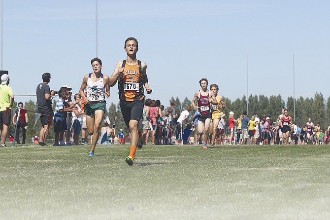 Dallas sophomore Trevor Cross sprints to the finish at the Ash Creek Cross-Country Festival on Saturday afternoon in Monmouth.