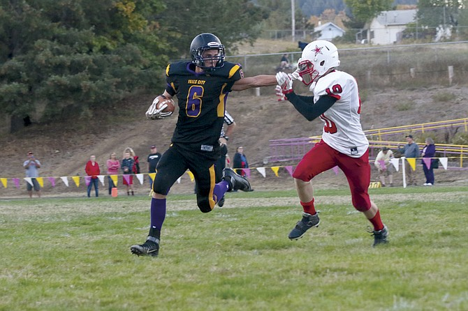 Falls City sophomore running back/defensive back Austin Burgess attempts to get past a Dufur defender during the Mountaineers' 54-12 loss on Friday night.