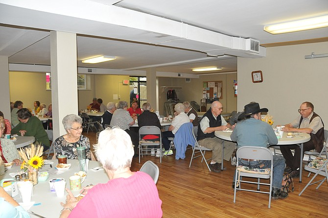 Senior Citizens from the Cottonwood, Greencreek and Craigmont area enjoy socialization prior to their meal at the recently renovated Cottonwood Community Hall Sept. 20. The City of Cottonwood received a grant to finish the hall's basement. The Prairie Senior Citizens are primary users of the facility, and meet Tuesdays at noon.