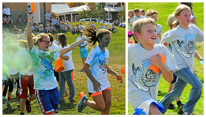 Grangeville Elementary School PTA was host to its annul Jogathon fund-raiser event for grades kindergarten through eighth Friday, Sept. 30. A twist this year was the middle school students had a color run where colored chalk dust was thrown. The event – with pledges from the community — raised more than $10,000. The funds are for the literacy program, a positive behaviors program, post testing assemblies, motivational speaker and more. Shirts for the run were fully funded by community sponsors. (Top) Laura Fischer and Christa Bledsoe run through the colors and (left) Ashton Cales and Dusty Bashaw take some laps.