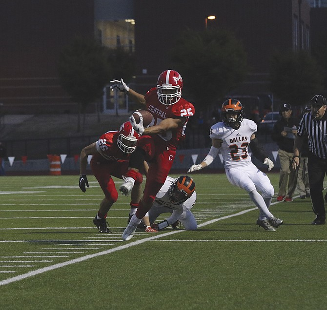 Central running back Alvin Berroa attempts to stay in bounds against Dallas on Friday.