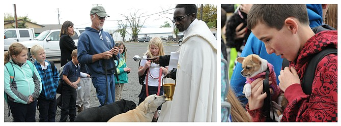 In honor of the feast day of St. Francis of Assisi, Father John Gathungu offered animal blessings for the pets of Sts. Peter and Paul School students Oct. 4. Father Gathungu is the priest at Sts. Peter and Paul Catholic Parish in Grangeville.