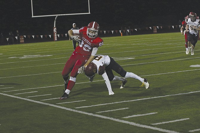 Central receiver Andrew Barry attempts to break out of a tackle on Friday night. Barry had four catches for 116 yards and two touchdowns during the Panthers' victory.