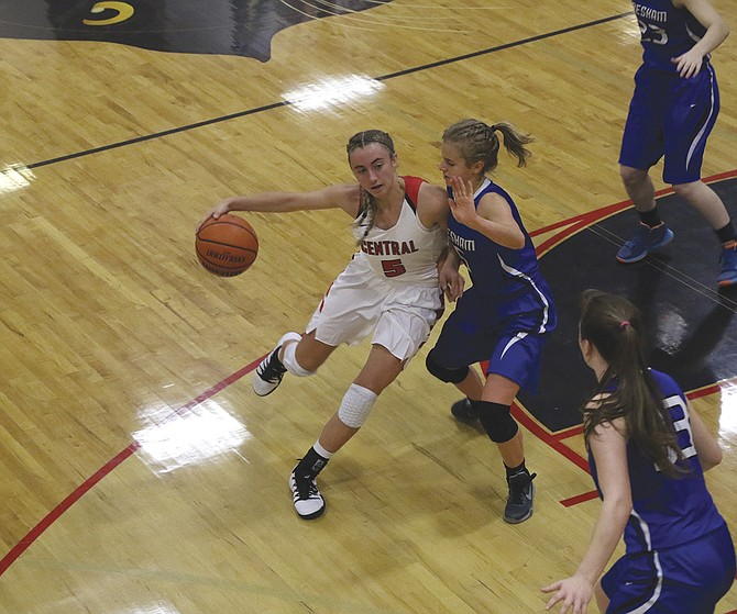 Meagan Mendazona looks to drive against a Gresham defender on Nov. 30. Mendazona scored nine points and grabbed 10 rebounds during Central's 36-30 victory.