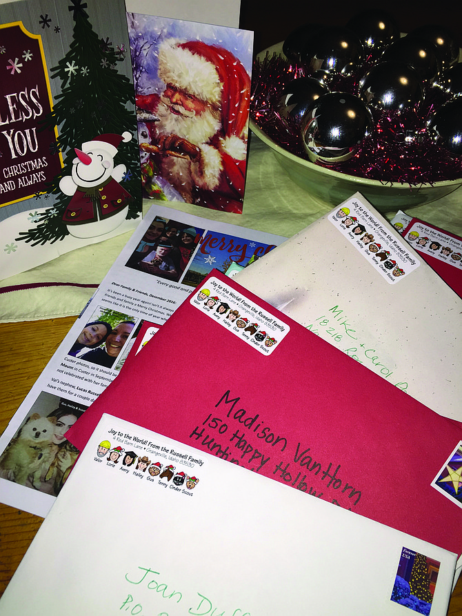 Idaho County Free Press readers vary on what they enjoy receiving in the mailbox for the Christmas season. Here, the reporter readies her 70-plus cards and letter to send to friends and family members.