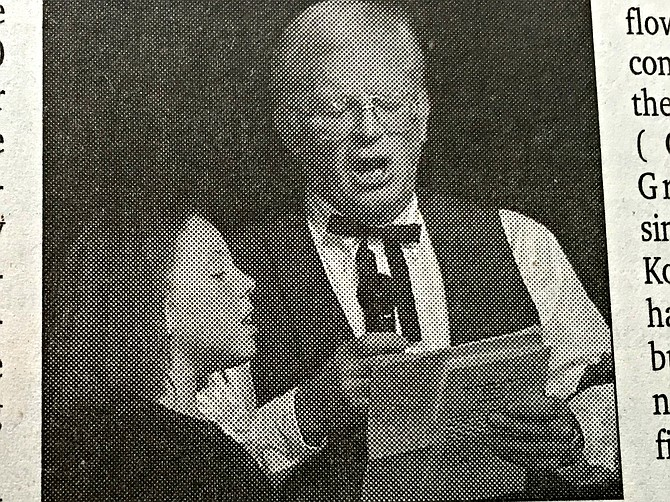 Ray Bloom and his granddaughter, Elizabeth, sing a duet at the 2006 Old Fashioned Christmas Variety Show at the Old Opera House Theatre in Kooskia. The Blooms and several other acts played to a full house two nights in a row.   Free Press archives