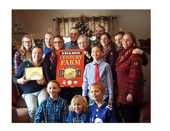 Century Farm Family: Stubbers Contributed photo / Earl Bennett The Stubbers family at the family farm in Greencreek not only had the kids home for Christmas, they also received a Century Farm certificate and plaque from the Idaho State Historical Society (ISHS), the Idaho Department of Agriculture and the governor's office. The award is given to a family that has held its farm in the family for 100 or more years. So far, ISHS has recognized more than 400 Century Farms in Idaho. The award was presented on Christmas day by Earl H. Bennett, ISHS, Genesee. Pictured are: 1—David Stubbers, 2—Juliana DeBlois, 3—Aidan DeBlois, 4—Jason Stubbers, 5—Heidi McRoberts, 6—Debbie Stubbers, 7—James Stubbers, 8—Rachel Stubbers, 9—Gerard DeBlois, 10—Anna DeBlois, 11—Lydia McRoberts, 12—Sydney McRoberts, 13—Ralph Stubbers, and 14—Craig Stubbers.
