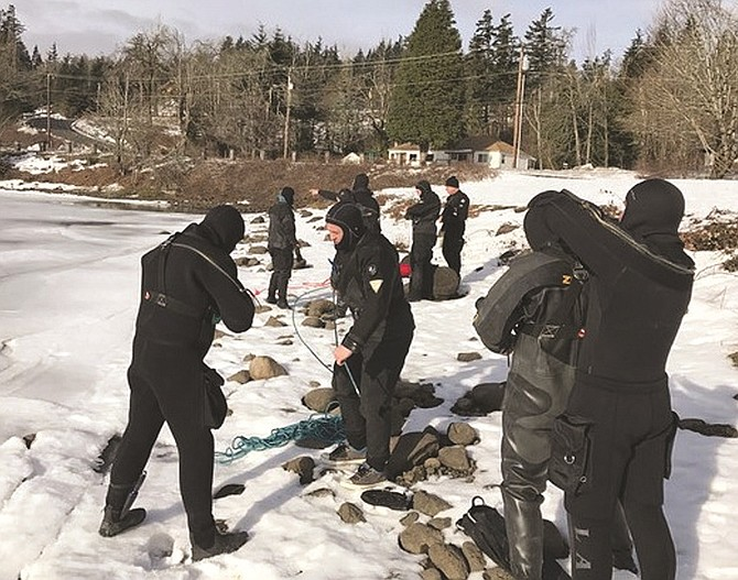 This past weekend, 10 members of the Skamania County Sheriff's Office Dive Rescue/Recovery Team honed their skills in Rock Creek Pond in Stevenson. Ice rescues takes specialized training and equipment in order to conduct a safe and successful rescue. (Photo courtesy of Skamania County Sheriff's Office)
