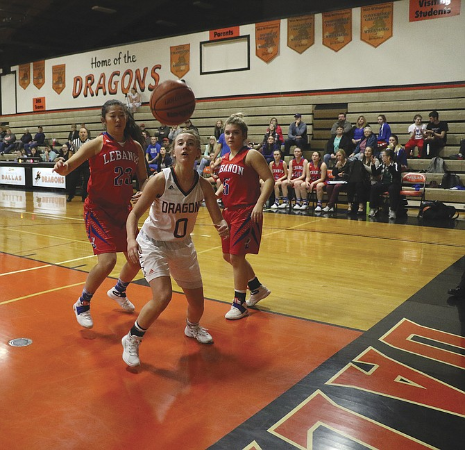 Dallas senior Olivia Nelson attempts to track down a loose ball against Lebanon.