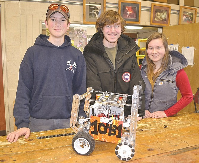 Sadie Hipskind (right), Calvin Kane (middle) and Canyon Willey (left) has a successful season this year representing Columbia High School's robotics club. Their team took first place at the regional meet last month, and participated in a super-qualifier tournament last weekend where they placed mid-pack out of 90 teams. The team's fourth member, Crimson Willey isn't pictured.