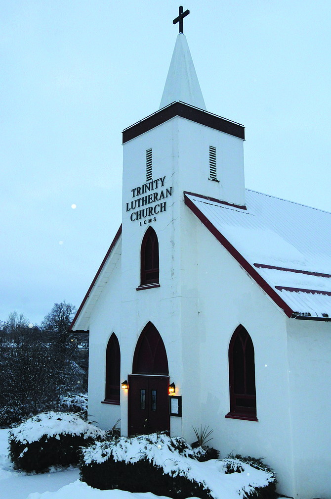Trinity Lutheran Church in Grangeville stands tall and proud and slightly sprinkled with snow this winter.