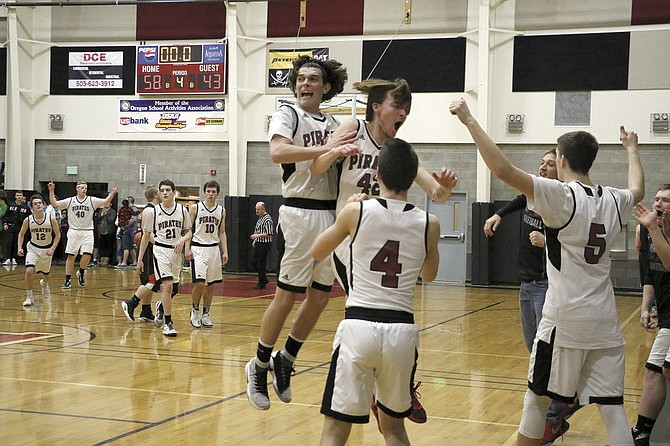 Players celebrate after Perrydale's victory over Powers on Friday night.