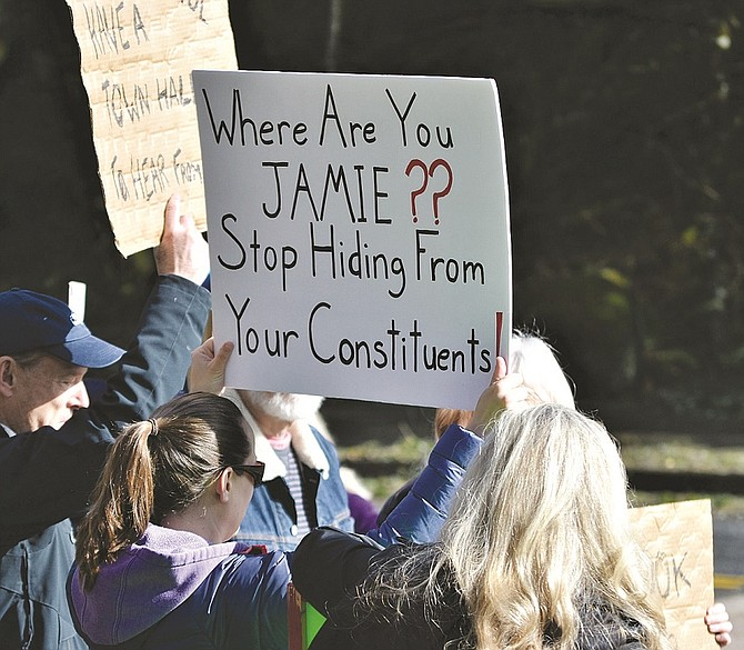 """About 20 protesters from Skamania, Klickitat, and Clark counties rallied outside of Skamania Lodge last Wednesday morning to protest U.S. Rep. Jaime Herrera Beutler's lack of town hall meetings. The congresswoman hasn't scheduled any town hall meetings for the last Congressional recess. Rep. Herrera Beutler was in Skamania County last week speaking at an economic development event at the Skamania Lodge. Attendees of the luncheon paid a plate fee. Before venturing to Stevenson, Rep. Herrera Beutler's staff held a telephone town hall Tuesday evening, which according to Skamania Lodge protesters, wasn't a legitimate town hall. Protesters said they were displeased that Herrera Beutler wouldn't meet with constituents. """"We want to be heard,"""" said Mary Kay McNallan, of White Salmon. """"She's supposed to represent everybody. We just want to be heard."""""""