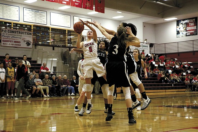 Central freshman Meagan Mendazona goes up for a shot against Thurston on March 1.