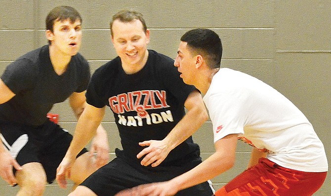 Sunnyside High School staff team member Andrew Borders moves in for steal against Mr. Sunnyside High School candidate Nate Cienfuegos during a fundraising event last night. As of press time, the amount raised for Children's Miracle Network was not available. The Mr. SHS pageant is at 7 p.m. March 18.