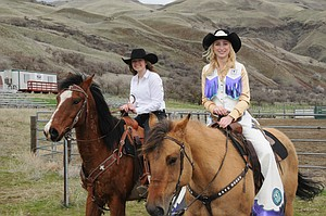Cassie Chandler of Slate Creek (left) tried out for White Bird Rodeo Queen for the coming year Saturday, March 18, and was crowned by last year's queen Bella Klapprich of Grangeville (right).