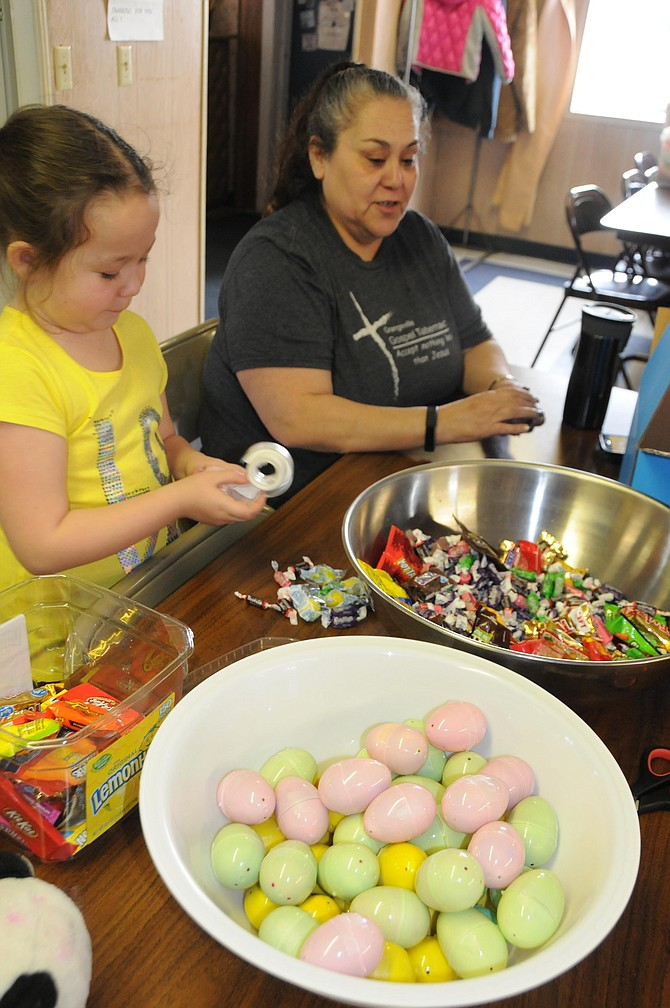 Gracie Stout, with help from her grandma, Yolanda Stout, helps fill plastic Easter eggs at the Eagles Hall Saturday, April 8. Grangeville Easter egg hunt is set for this Saturday, April 15, 10 a.m., Lions Park, for children ages 1-12. This is sponsored by Grangeville Eagles Auxiliary No. 539 who is accepting donations of cash, candy, eggs and baskets. For questions call Yolanda at 983-2131. Check eggs at the hunt for special prize tickets this year. Donate eggs back to the Eagles at the event for next year's hunt.