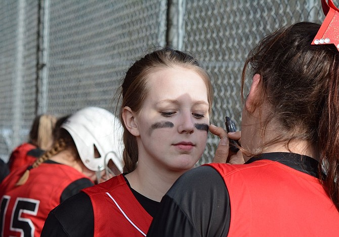 Kathirin Hylton applies eye black under Kaycee Radke's eyes March 31 during a break in Columbia High's non-league double-header against visiting Fort Vancouver. After spring break, the Bruins returned to action on April 11 at home against Lyle/Wishram/-Klickitat.