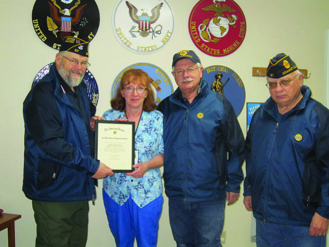Contributed photo American Legion Post No. 37 held its annual awards and birthday party recently. Lori Graham received the Nurse of the Year Award for her work at the Grangeville Syringa Veterans Administration Clinic. She is being presented with the award here by Post Commander Don Owen, vice commander Roy Lombardo and service officer Morris Bentley.