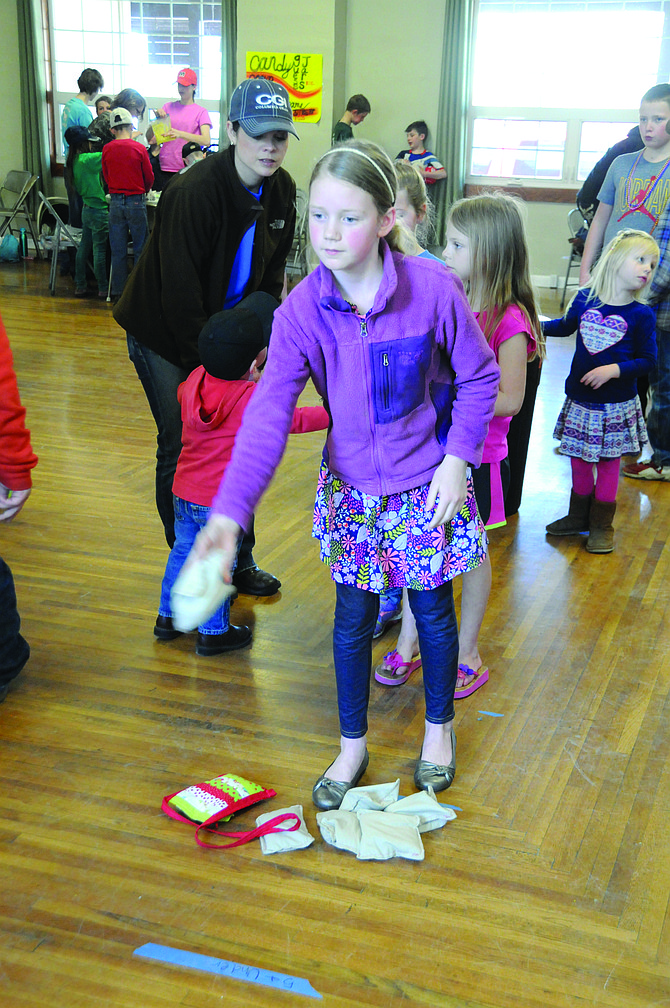 Kate Foster of Grangeville takes a turn at a beanbag game April 22 at Cottonwood.