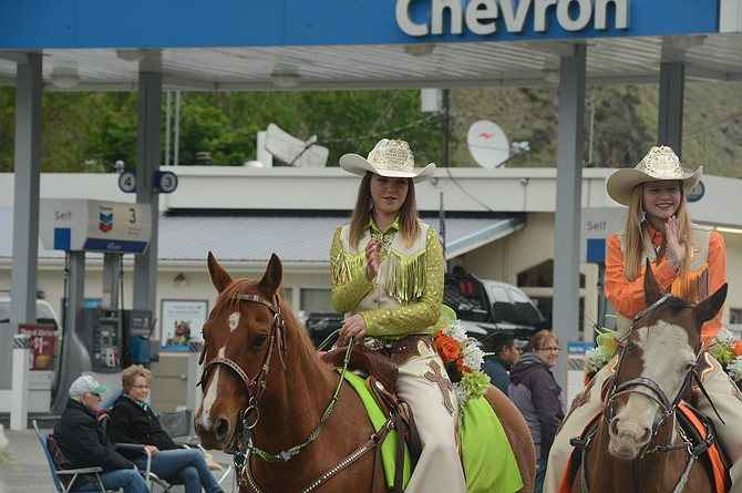 "Clearwater Valley Roundup Association Queen Tayscha Mozley (right) and Princess Shelbie Miller (left) received a first-place ribbon in the ""Mounted Royalty"" division at the Riggins Rodeo Parade Sunday, May 7."