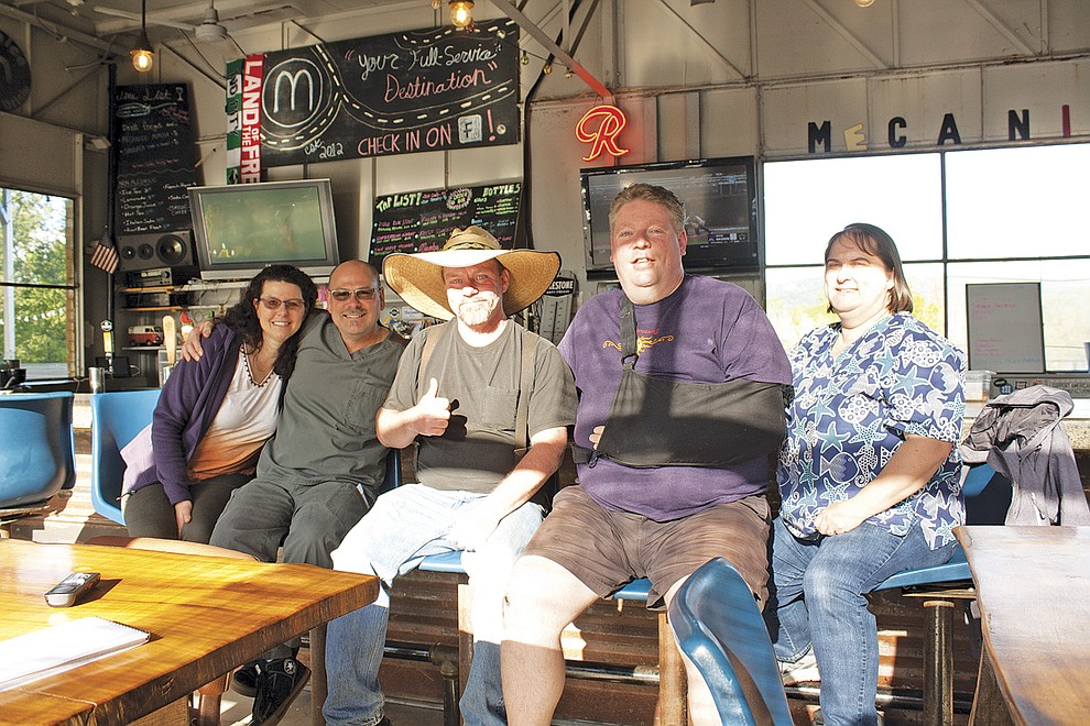 Ray Walter, center, runs the barbecue at IndePit at Mecanico in Independence.