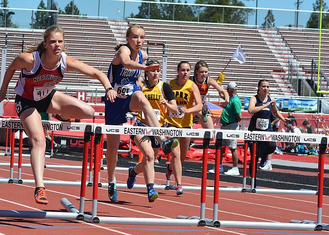 Trout Lake freshman Sidney Becker (second from left) is on her way to setting a personal-best time of 16.80 seconds in a 100-meter hurdles qualifying heat last Friday.