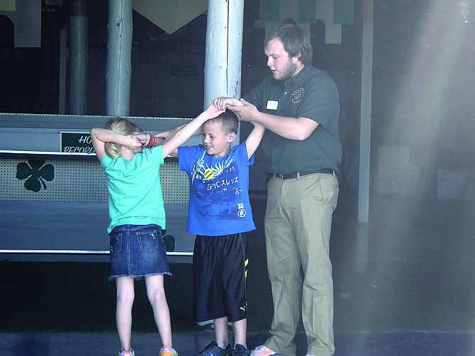 Contributed photo Idaho County 4-H Ambassador Mitchel Nuxoll teaches two young  4-H members the western swing.
