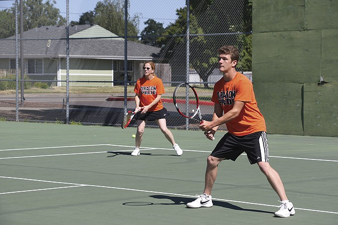Alice and Ryan Bibler compete during the Monmouth-Independence Fourth of July Tennis Tournament on Sunday.