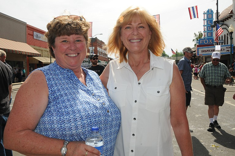 Grangeville High School class of 1978 friends (L-R) Teresa Groom and Kim Cash Hulla are seen here following the July 4, 2017, Border Days egg toss.
