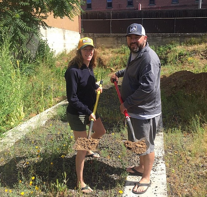 Christine and Doug Ellenberger of Everybody's Brewing hold shovels of dirt after breaking ground June 28 on the site of their planned expansion of the White Salmon brewery and pub's footprint on the south side of E Jewett Boulevard. (Facebook photo)